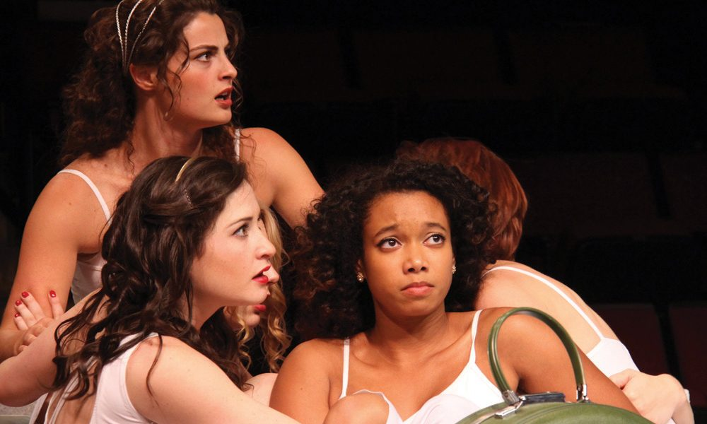 Three women in tank-tops sit by one another in CRT Big Love Production