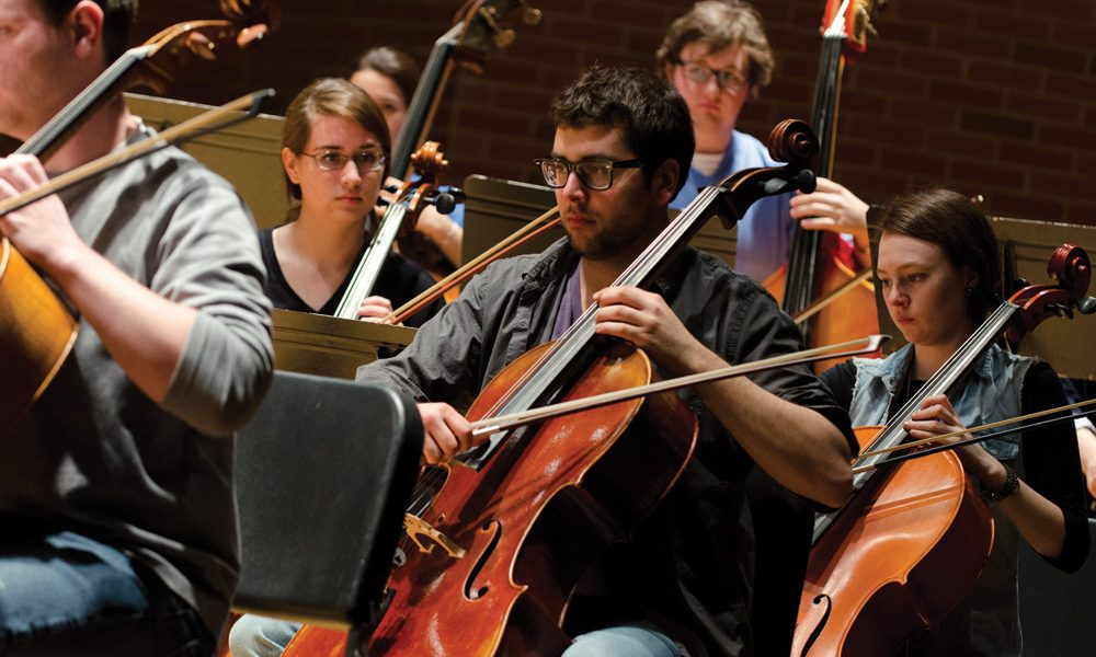 Students from the UConn Symphony Orchestra rehearse in von der Mehden Recital Hall