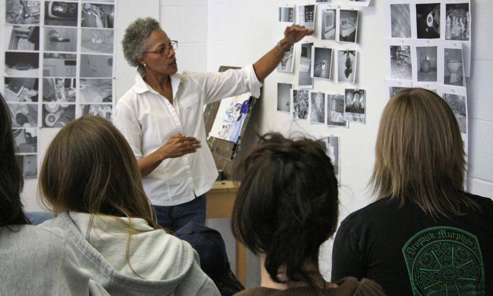 Deborah Dancy critiques students work at the Fine Arts Building.