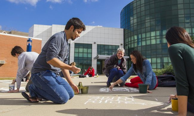 Fine Arts Students Chalking on sidewalk