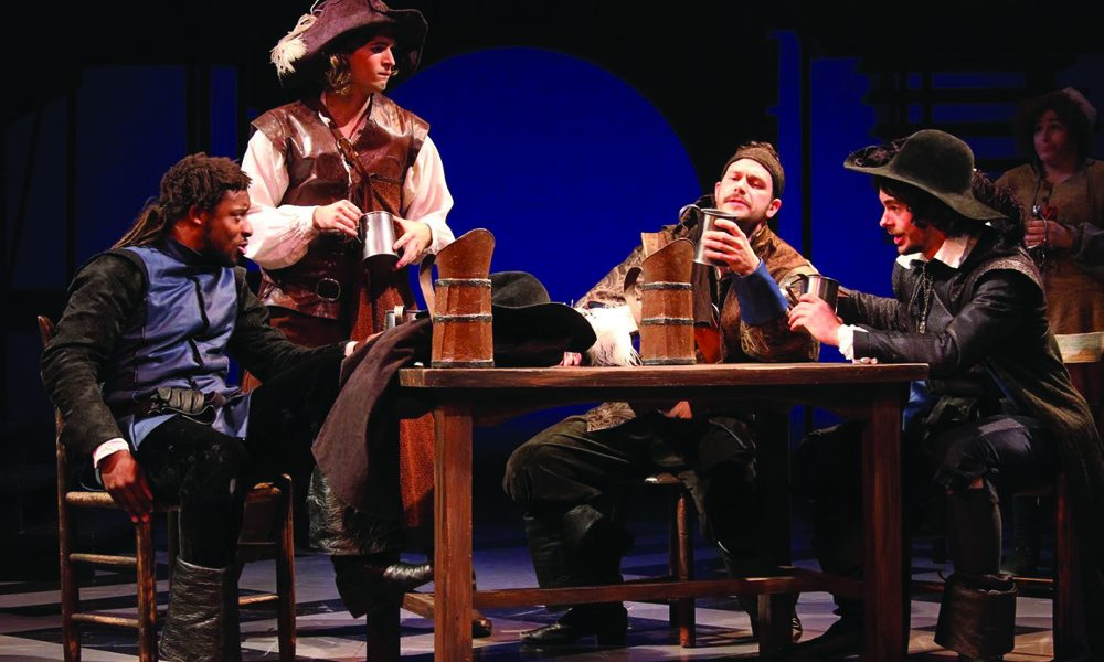 "Four costumed male students seated around table in ""pub"",  UConn Drama 1776 Production"