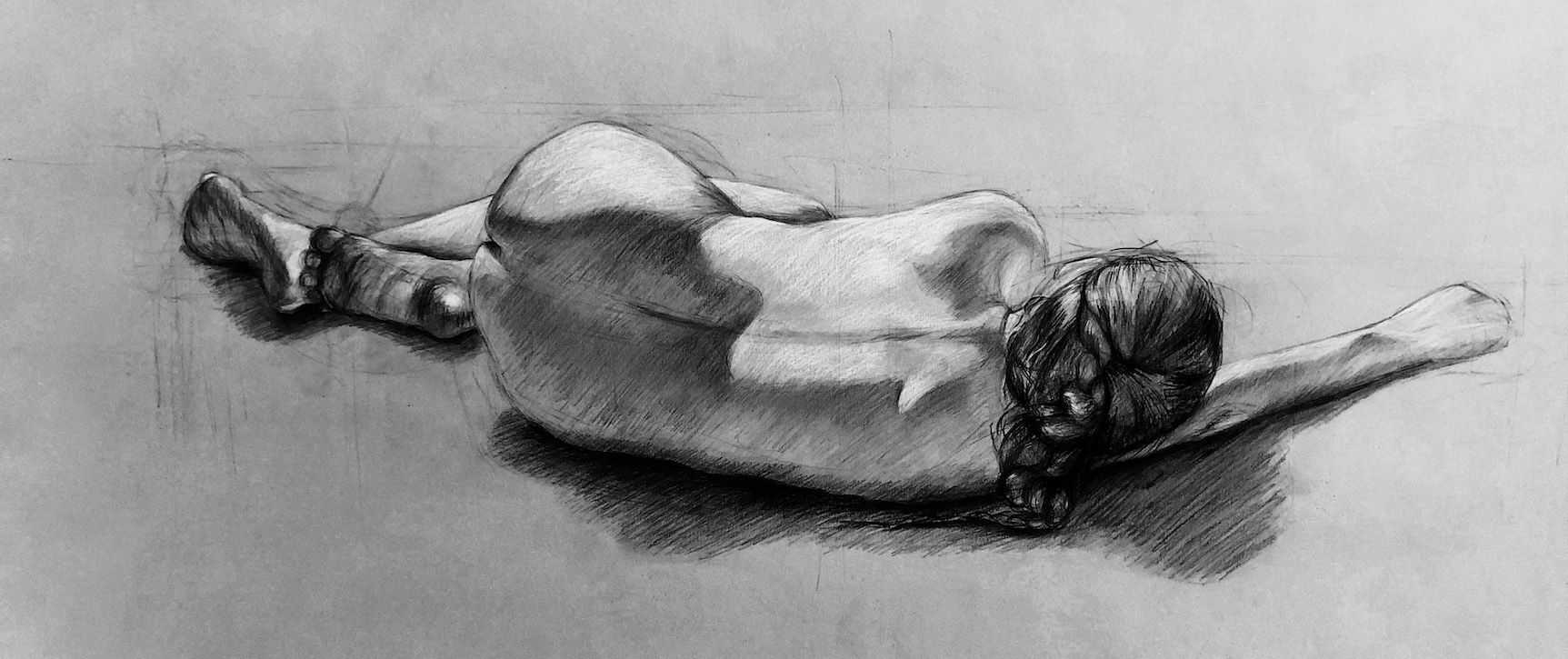 life drawing in charcoal of a woman lying on her side, by Hannah Kim