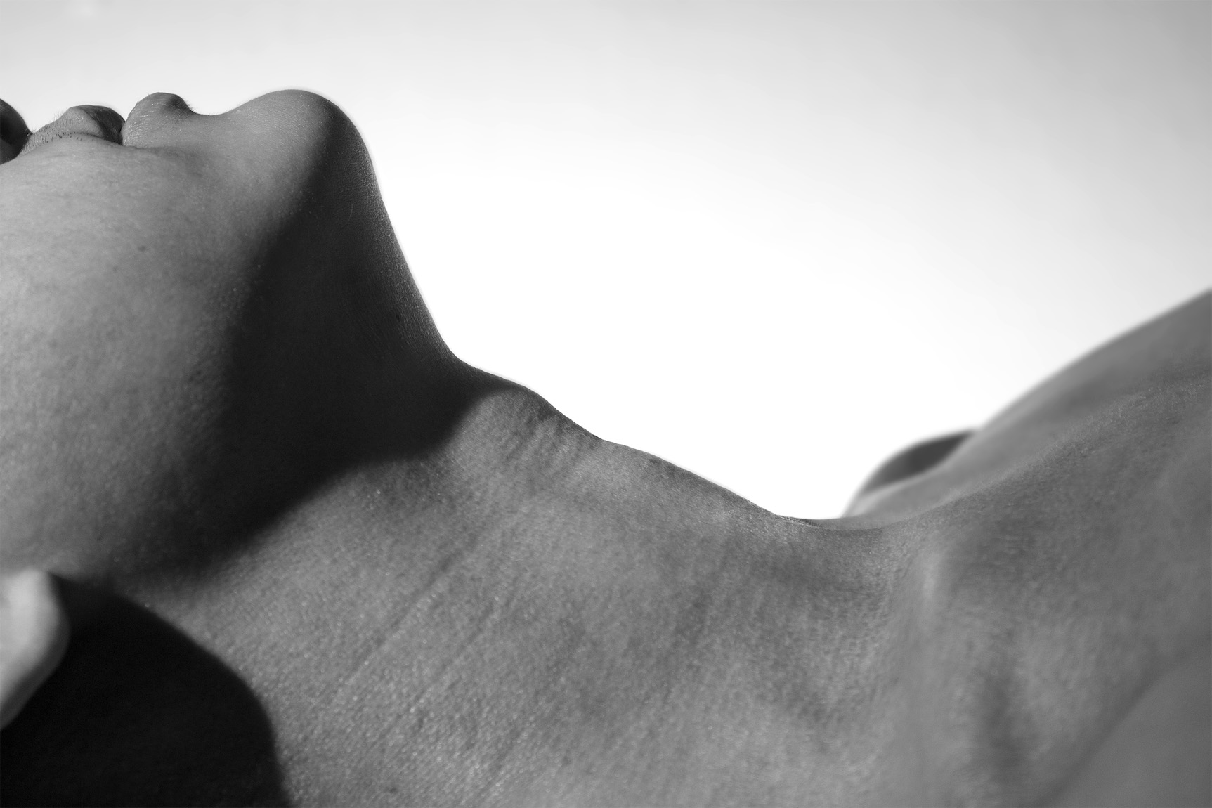 hannah kim's photograph of a woman's neck and chin in profile